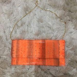 Carlos Falchi neon orange python snakeskin clutch